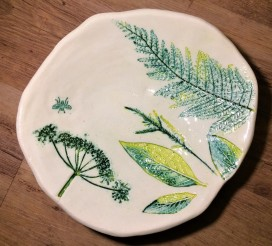 platter with impressed leaves and plants